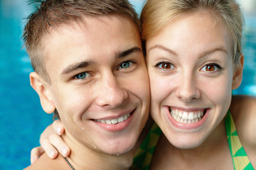Close-up portrait of a young couple at the swimming pool
