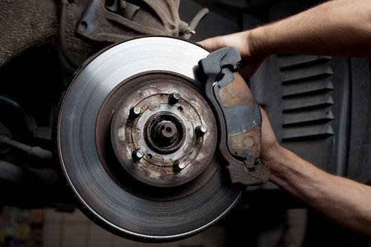 Car mechanic repair brake pads