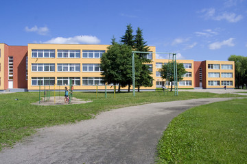 Exterior view of school building with playground.