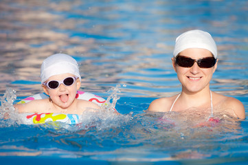Mother with child in swimming pool