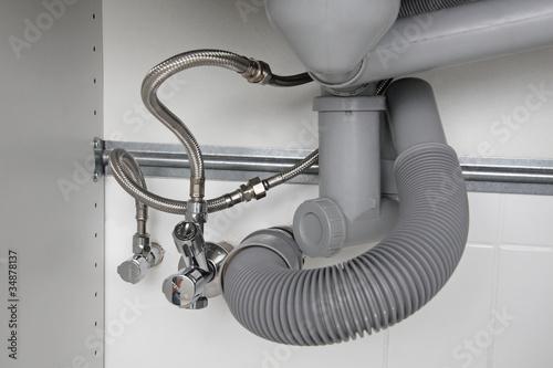 raccordement siphon vier robinet double photo libre de droits sur la banque d 39 images fotolia. Black Bedroom Furniture Sets. Home Design Ideas