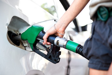 woman hand holding fuel nozzle