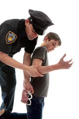 Policeman arresting a teen criminal