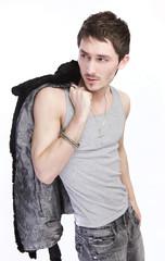 Man in a fur coat. Fashion photo.