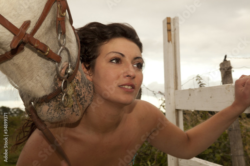 Girl Posing With A Horse
