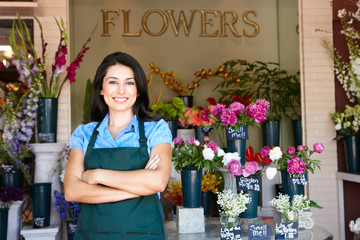 Woman standing outside florist