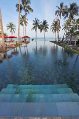 Marble steps leave under pool water