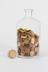 coins in glas bottle