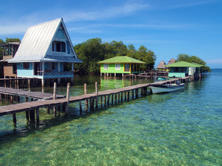 Caribbean resort over the sea with wooden dock and bungalows on stilts, Crawl Cay, Bocas del Toro, Panama, Central America