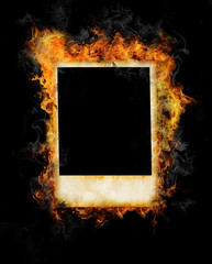 Old blank photo frame in fire