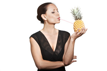 Portrait of beautiful woman drinking juice through pineapple