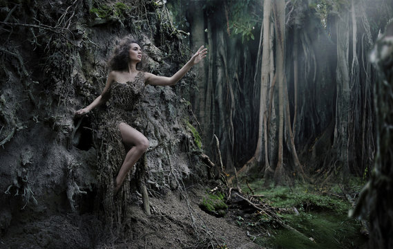 Sexy woman as a part of tree