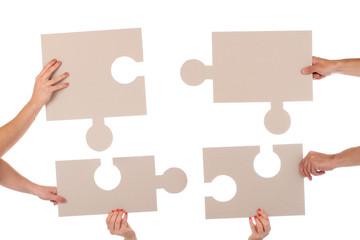 Puzzlestücke Hände