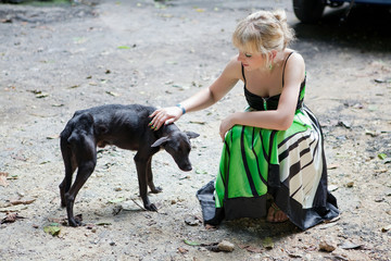 Woman with a poor stray dog