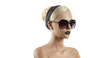 fashion shot of blond girl with sunglasses against white backgro