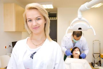 A portrait of a dental assistant