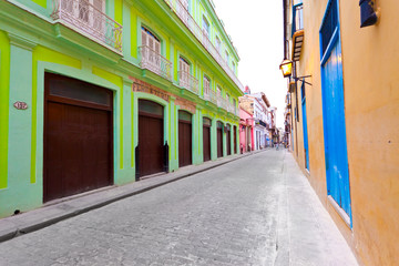 Street in Old Havana sidelined by colorful buildings