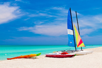 Sailing boats and water bikes in the cuban beach of Varadero