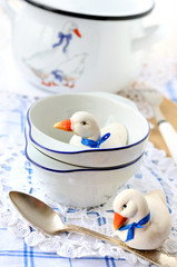 Still life with cookware in white and blue colors with ducks
