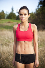 Mixed race jogger standing in field