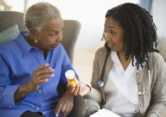 Nurse explaining medication to woman