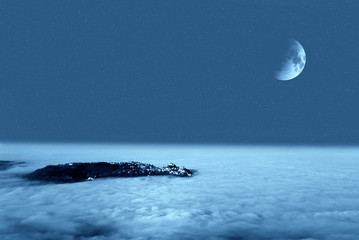 night sky with moon and fog in the valley