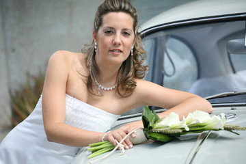 young bride looks at the camera and smiles, wedding photo