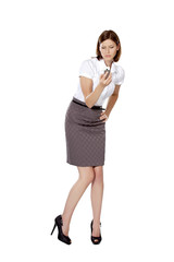 Beautiful young businesswoman holding phone