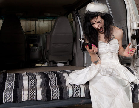 Stood up angry bride screaming at her phone