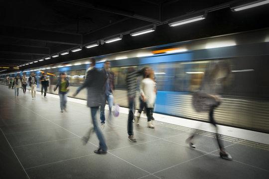 Blurred people on subway platform