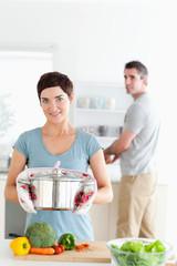Woman holding a pot