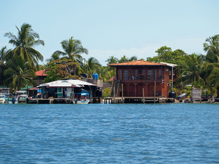 Tropical coast with a Caribbean house and a small fuel station for boats, archipelago of Bocas del Toro, Carenero island, Panama, Central America