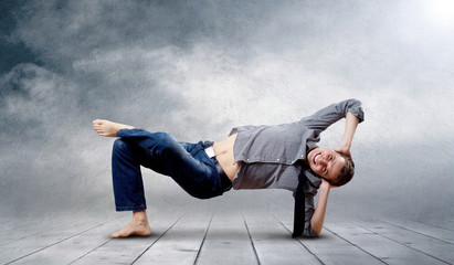 Young man dancer in new stay pose