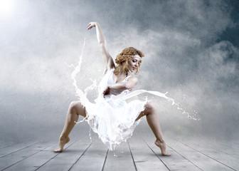 Dance of ballerina with dress of milk