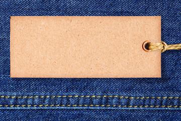 Vintage paper banner -  tag on blue denim..