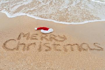 Merry Christmas written on tropical beach sand