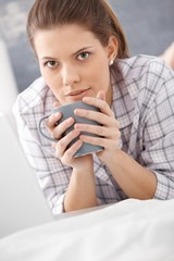 Morning portrait of woman drinking coffee
