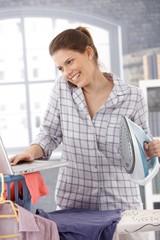 Laughing modern woman multitasking