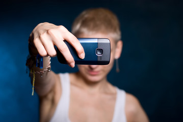 Girl photographing on phone