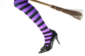 The legs of a witch flying on her broomstick.