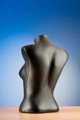 Clothing mannequins against gradient background