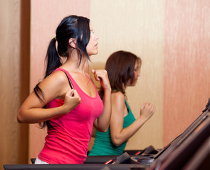 Young women on a running simulator