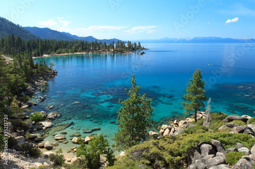 Wall mural Lake Tahoe overview with kayakers on water