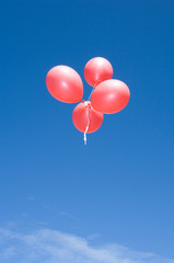 Flying balloons on blue backround