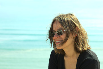 Portrait of a smiling young woman in sunglasses