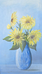 Lush bouquet of delicate sunflowers in blue vase