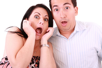 young adult couple in cinema movie theater scared while watching