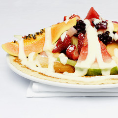 French style crepes with fresh fruits and custard cream