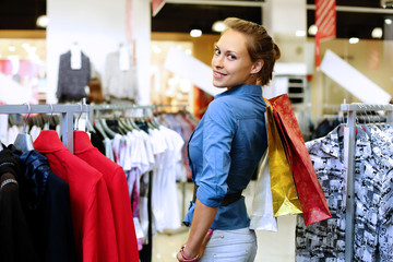 Young girl buying clothes