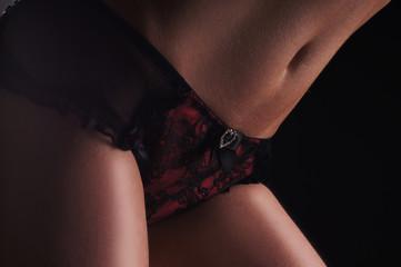Beautiful female body over black background
